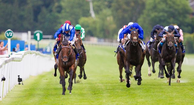 Mukhadram ridden by Paul Hanagan (front left) wins the Coral-Eclipse at Sandown.