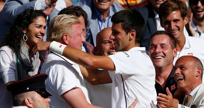 Novak Djokovic hugs Boris Becker after winning Wimbledon this year
