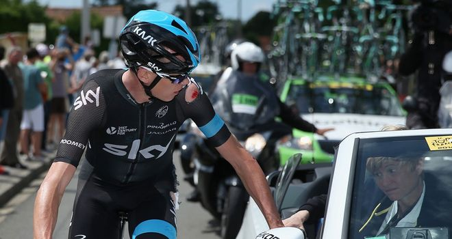 Chris Froome receives medical treatment following his crash on stage four