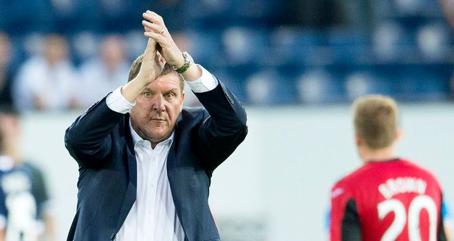 St Johnstone manager Tommy Wright applauds the fans at full-time