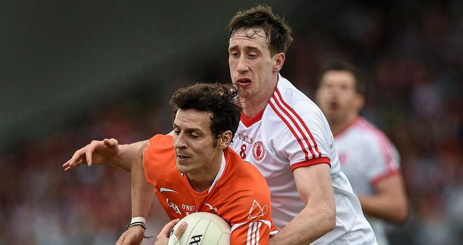 Armagh forward Jamie Clarke is tackled by Colm Cavanagh