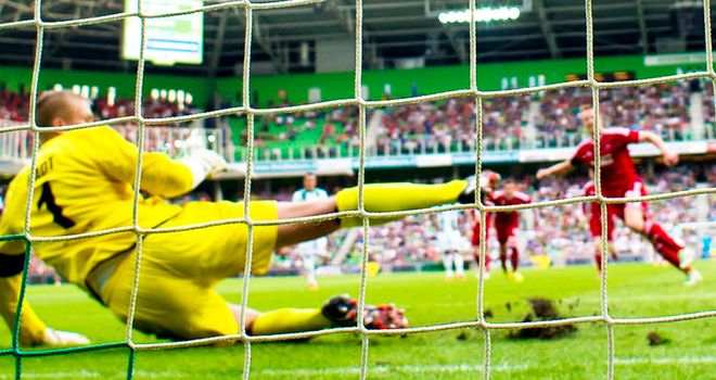 Adam Rooney gives Aberdeen the lead from the penalty spot in Groningen