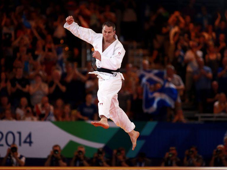 Euan Burton celebrates winning gold over Shah Hussain Shah