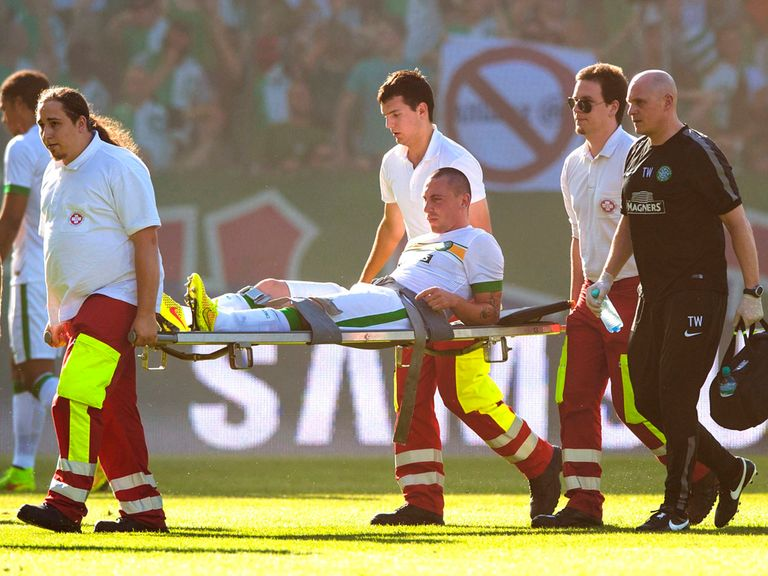 Celtic's Scott Brown is carried off