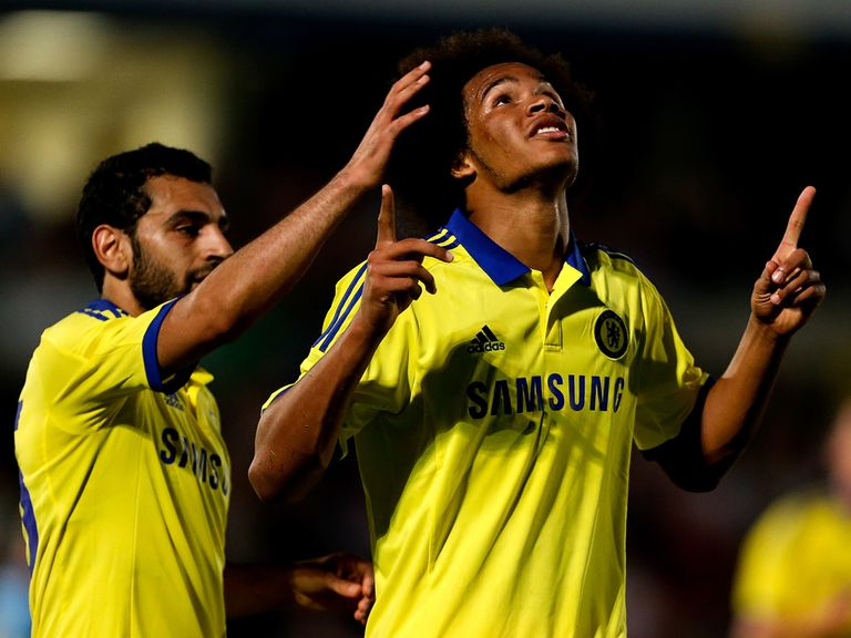 Izzy Brown of Chelsea celebrates scoring at Adams Park