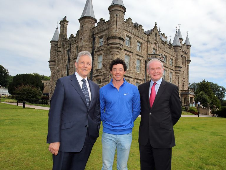 McIlroy poses with Robinson (l) and McGuinness (r) at Stormont - but without his trophy