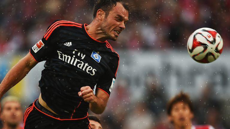Hamburg striker Heiko Westermann heads for goal