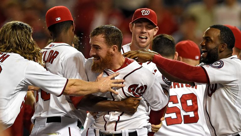 Adam LaRoche is mobbed by team-mates after his walk-off solo home run