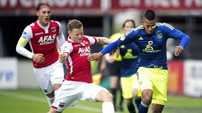 Ajax forward Ricardo Kishna vies for the ball with AZ Alkmaar defender Mattias Johansson