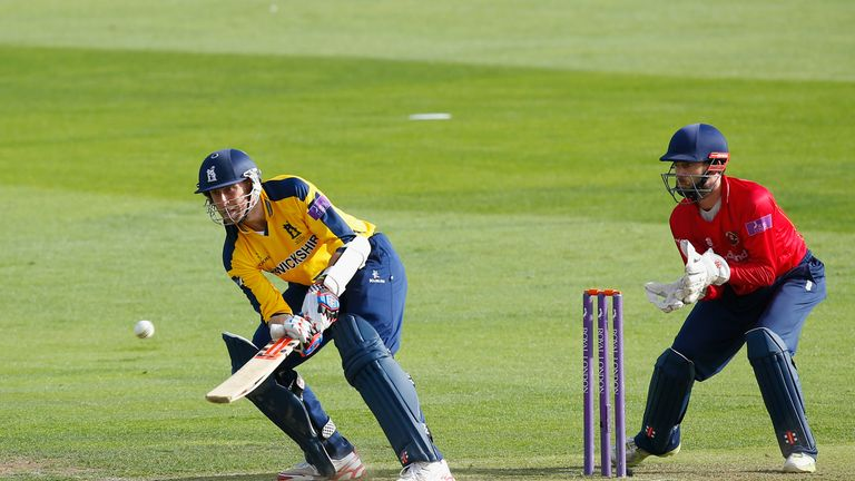 Rikki Clarke of Warwickshire hits out watched by Essex wicketkeeper James Foster