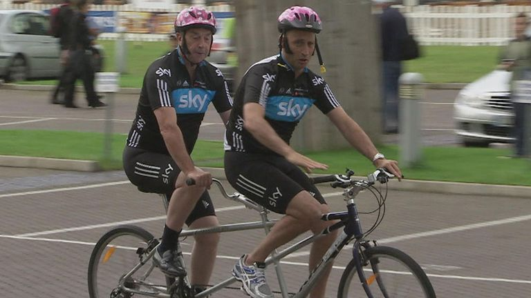 Bumble - sporting smart shoes - arrives with Nasser on a tandem