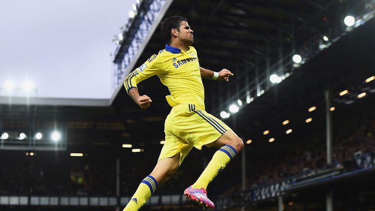 Diego Costa celebrates scoring his team's sixth at Everton