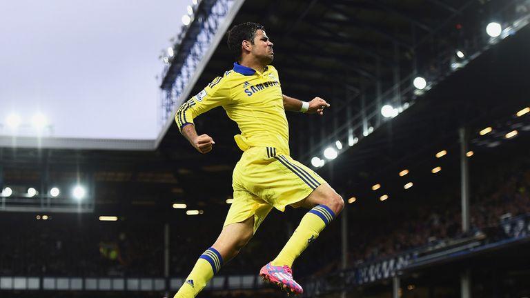 Diego Costa celebrates scoring his team's sixth at Everton