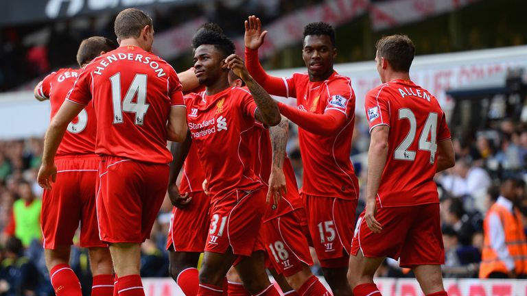 Liverpool's players congratulate Sterling after his opening goal at White Hart Lane