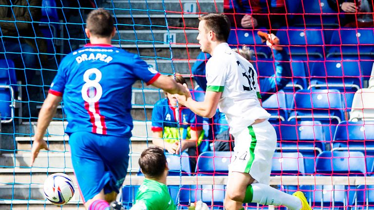 Inverness Caley score as the ball rebounds off young Celtic defender Eoghan O'Connell (r)