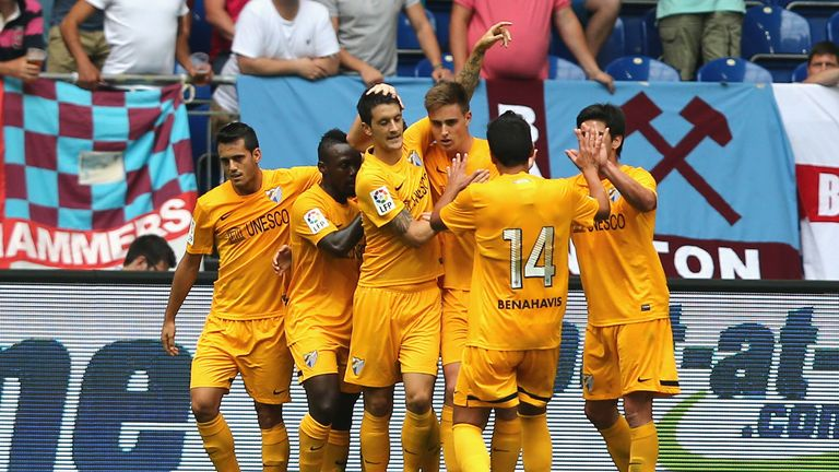Malaga celebrate after scoring against West Ham in the Schalke Cup