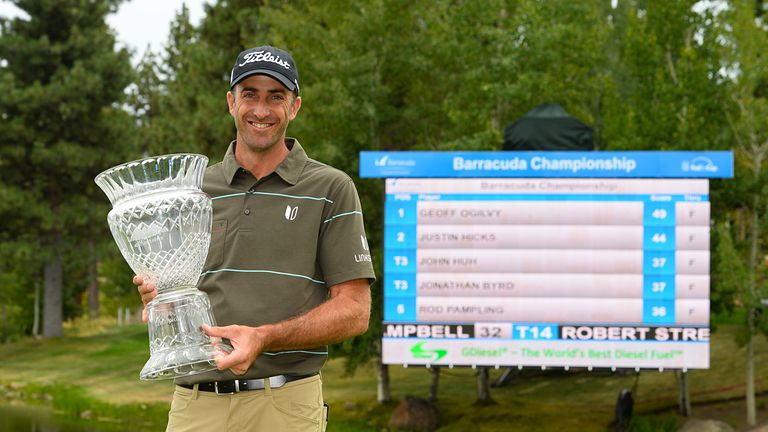 Geoff Ogilvy of Australia poses with the trophy at the Barracuda Championship