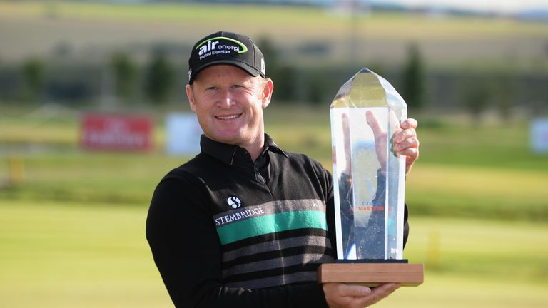Jamie Donaldson poses with the trophy