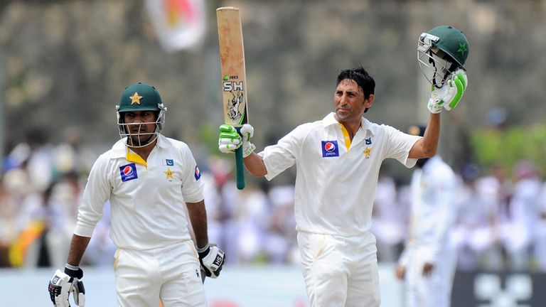 Younis Khan: Raises his bat and helmet in celebration after scoring 150 runs