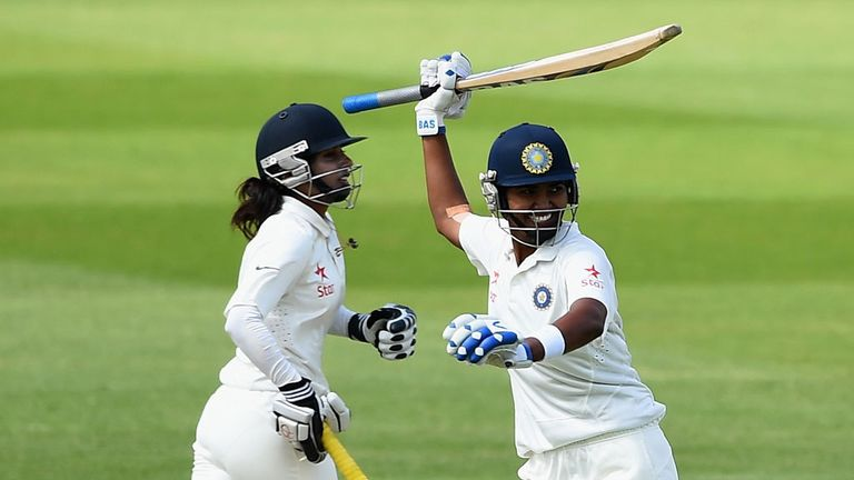 Shikha Pandey and Mithali Raj celebrate securing India's six-wicket victory