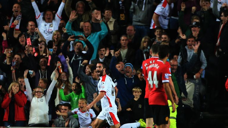 MK Dons celebrated a famous win over Man Utd in the Capital One Cup on Tuesday