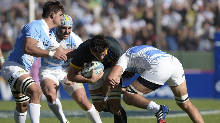 Francois Louw: Tackled by Argentina's Juan Fernandez Lobbe (R) and Pablo Matera (L)
