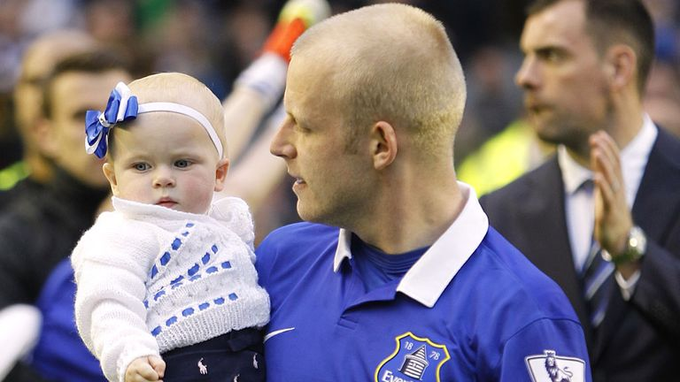 Everton's Steven Naismith carries his daughter around Goodison Park following their final home game of the season in May