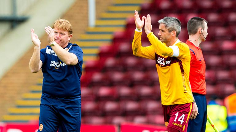 Stuart McCall and Keith Lasley applaud the Motherwell fans at the end of the match