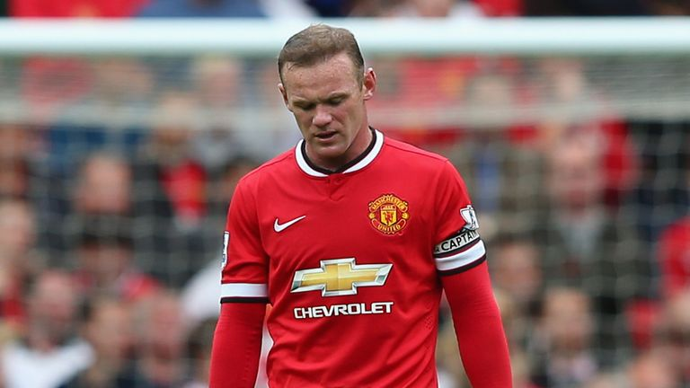 Wayne Rooney: Looks disconsolate as Manchester United lose 2-1 at home to Swansea