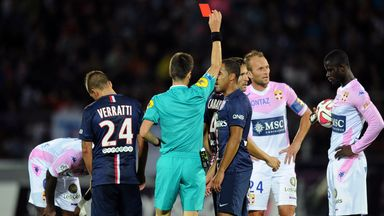 Yohan Cabaye is shown the red card