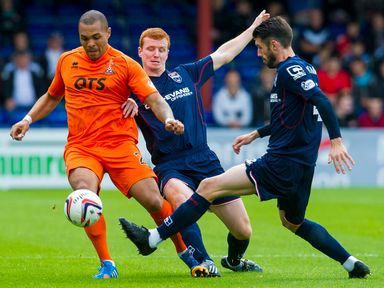 Scott Boyd and Rocco Quinn challenge for the ball against Josh Magennis