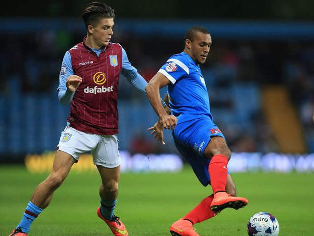 Aston Villa's Jack Grealish chases after Leyton Orient's Jay Simpson