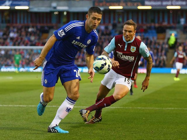 Gary Cahill of Chelsea is closed down by Matt Taylor