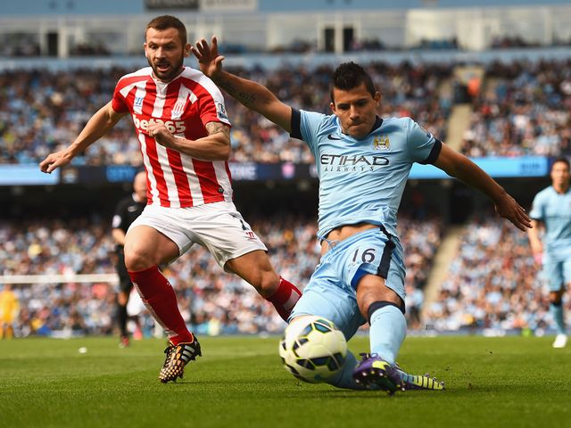 Sergio Aguero of Manchester City shoots under pressure from Phil Bardsley