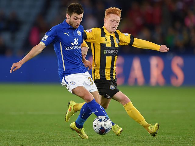 Michael Cain of Leicester (left) in action with Ryan Woods of Shrewsbury