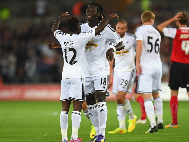 Swansea's Nathan Dyer (left) celebrates with goalscorer Bafetimbi Gomis