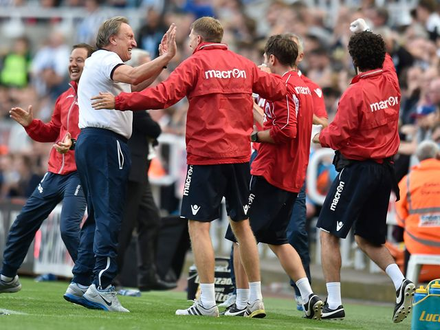 Neil Warnock celebrates with the Crystal Palace staff at full-time