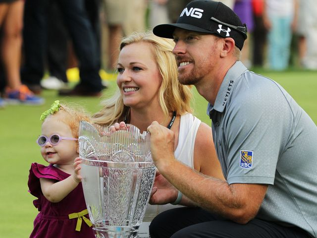 Hunter Mahan celebrates with wife Kandi and daughter Zoe