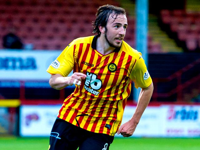 Partick's Stuart Bannigan celebrates his opener against Ross County