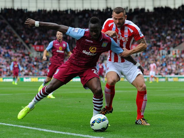 Aly Cissokho holds off Phil Bardsley of Stoke City