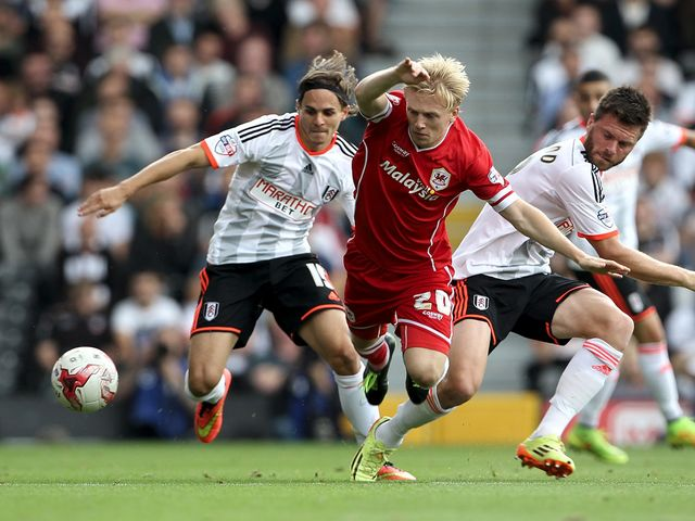 Fulham's Tim Hoogland and Cardff City's Mats Daehli battle for the ball