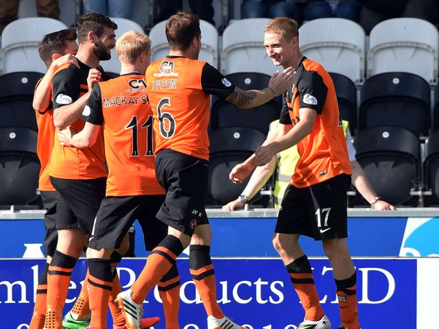 Dundee united's Chris Erskine (right) celebrates after opening the scoring
