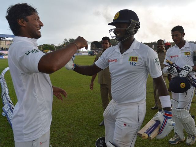 Angelo Mathews and Kumar Sangakkara celebrate after winning the first Test