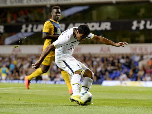 Tottenham Hotspur's Paulinho shoots to score his team's second goal