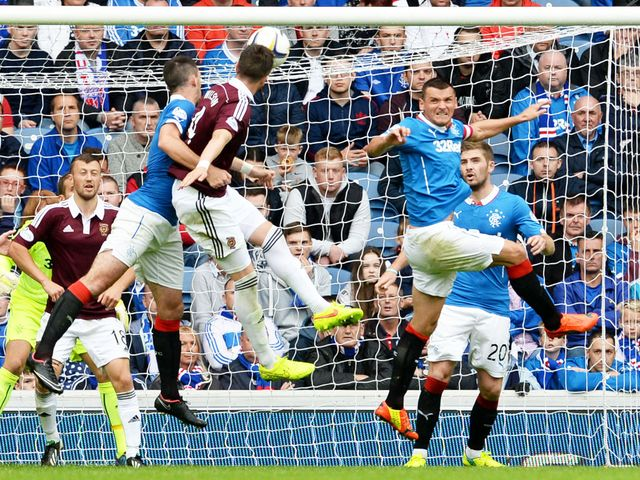 Danny Wilson scores the opening goal with a powerful header