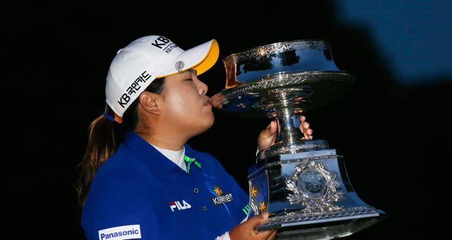Inbee Park kisses the trophy after winning the Wegmans LPGA Championship
