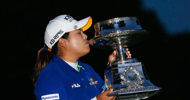 Inbee Park kisses the trophy after winning the Wegmans LPGA Championship