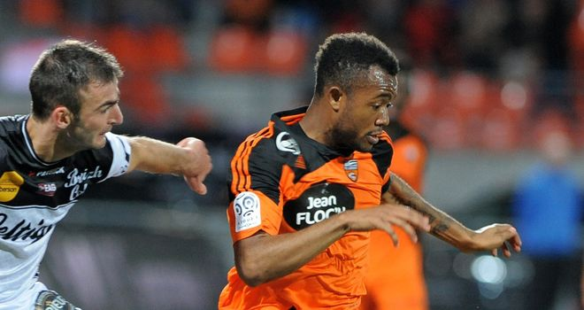 Lorient's forward Jordan Ayew vies with Guingamp's Reynald Lemaitre