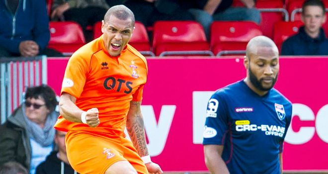 Josh Magennis: Kilmarnock striker celebrates his opening goal against Ross County