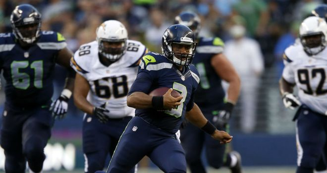 Russell Wilson: Rushed for two touchdowns in Seattle's warm-up win over San Diego
